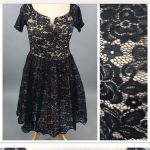 Size 12 Lacey Cocktail Dress with flouncy skirt.